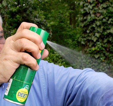 15764 a man spraying insect spray on his shirt pv